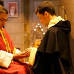 Br Sebastian Condon keeling during his first profession