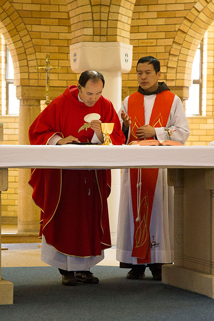 Fr Francis Ching hears the Mass