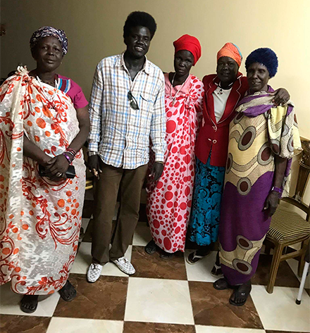 Aguek Nook with his mother and friends