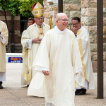 Deacon Andrew O'Brien walks through the guard of honour following his diaconal ordination.