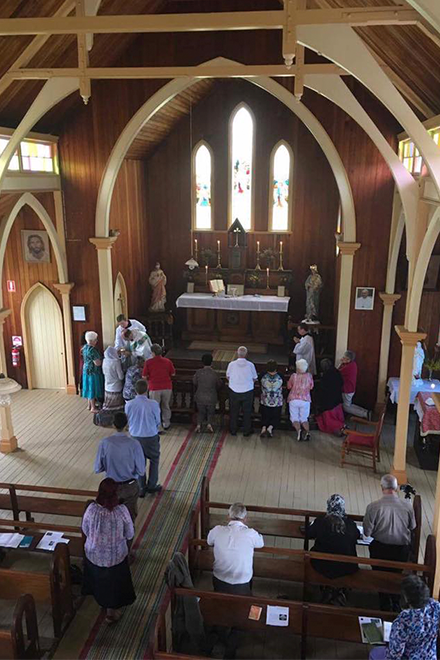 Worshippers receive Holy Communion on the tongue during Latin Mass at Mt Perry