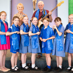 Brisbane Catholic teacher dedicates first song to refugees