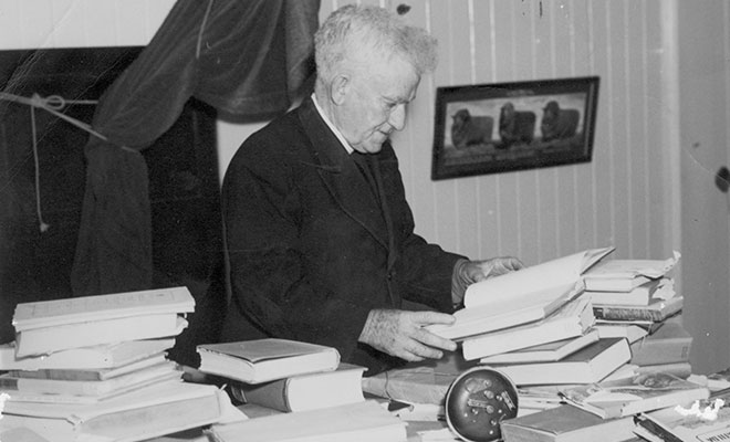 Fr Hayes with his books