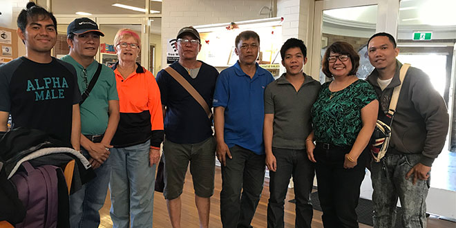 Roslyn Rajasingham with volunteers and drivers from Apostleship of the Sea.