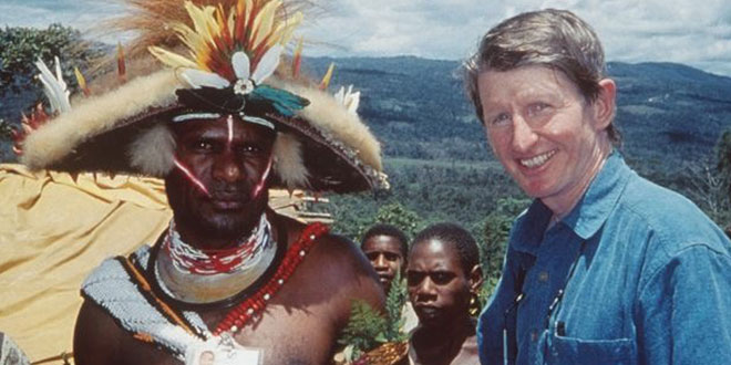 Sean Dorney with a huli wigman in PNG