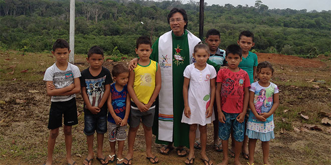 Fr Manh Le and children from Brazil