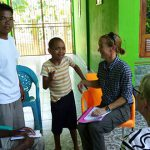 Dr Moss meets with a child in Flores