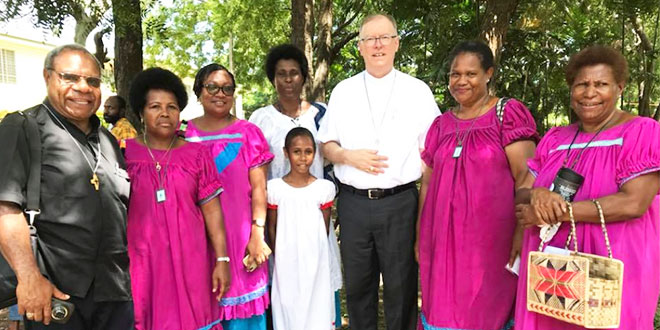 Bishop Ken and locals
