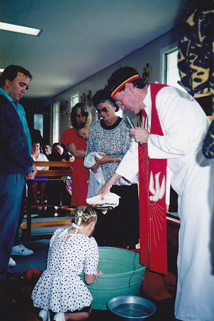 Fr Gerry Hefferan baptises a child