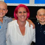 Students shave their head for a cure at Kenmore