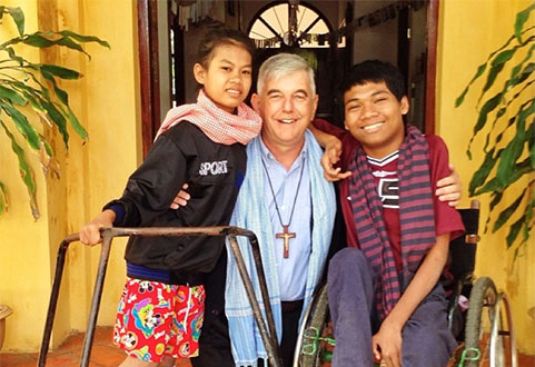 Bishop Figaredo with Cambodian disabled children