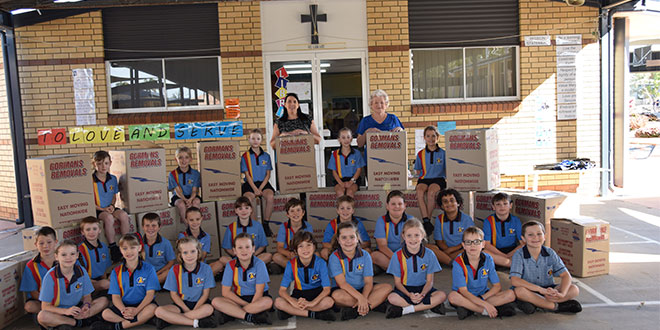 Year 3 class at St Mary's with their removal cartons of items