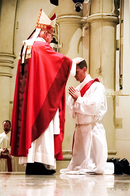 Archbishop Coleridge lays hands on Deacon Thomas Zaranski