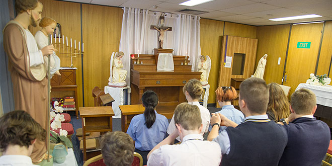 Angelorum College students and staff praying the Rosary