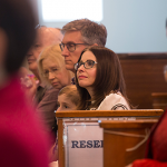 Erin Bledsoe listening to the Archbishop's homily
