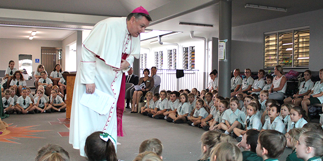 Bishop Tim Harris talks to students in a classroom