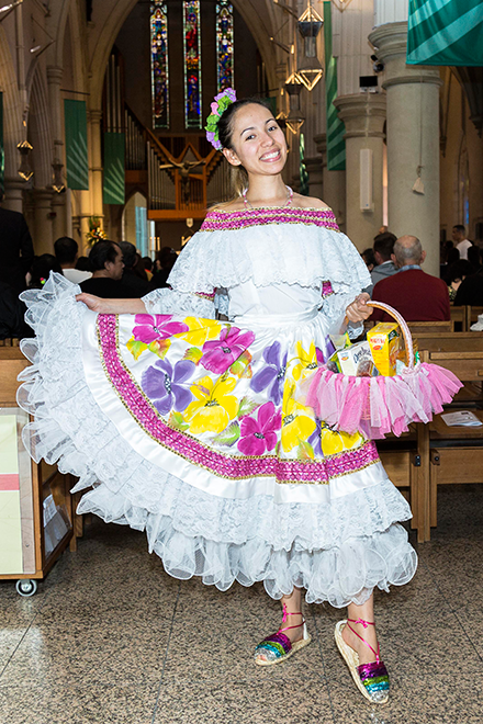 Margareth Pena represents the Catholics from Colombia as she prepares for the start of the Mass. Photo: Alan Edgecomb