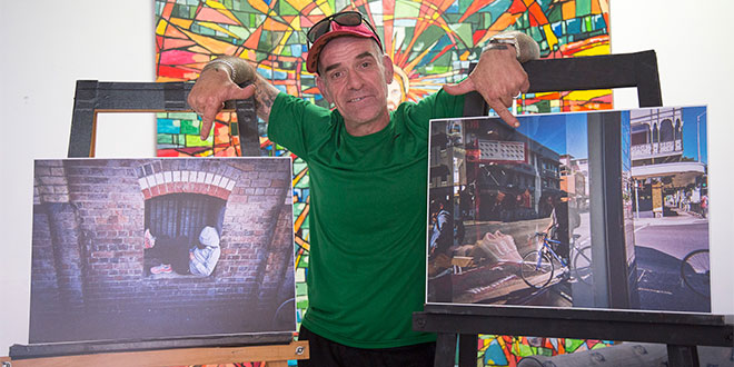 Paulie with his photographs