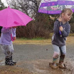 Children play in a puddle in Maryvale