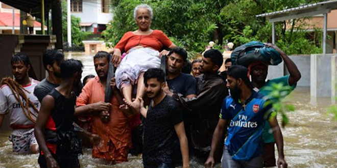 Elderly woman carried through floods