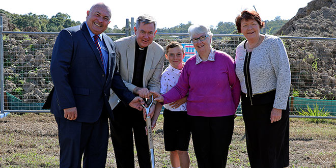 Turning the sod at the site of Good Samaritan Catholic College