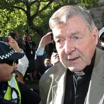 Cardinal George Pell sentenced to six years jail for abusing two choristers in the 1990s
