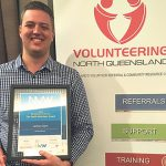 New Catholic wins a volunteer award, embracing the social justice teaching of the Church