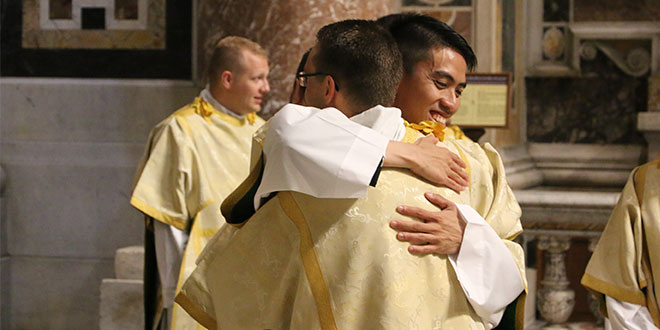 Congratulations: Deacon Adi Indra congratulates other new deacons after their ordination.