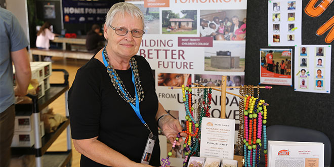 Making a difference: Helen Plant showing off the hand-made Rosary beads from Uganda at the Impact stall at the Ignite Conference in Brisbane recently.