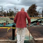 Lost it all: Rappville resident John Duncan looks at the remains of his home. Photo: Carol Duncan