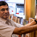 St Paul's Book Centre manager Fr Thomas Manimala pulls out a book