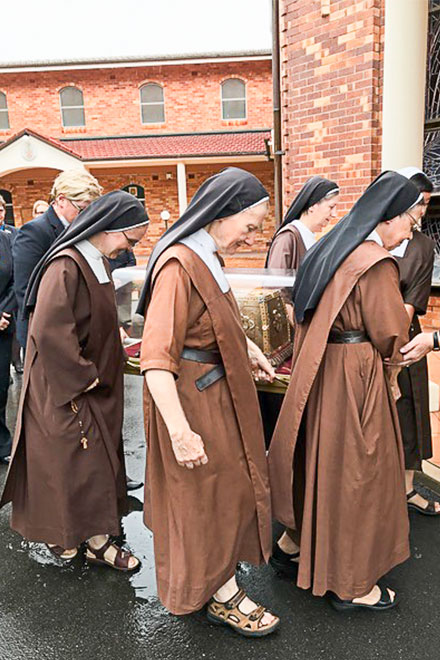 Sisters carrying the relics of Sts Zelie and Louis Martin