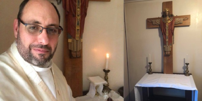 Fr Adrian Sharp before offering Mass in self-isolation