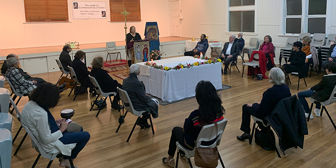 Queensland churchgoers rejoice in easing restrictions by gathering at the table of the Lord again