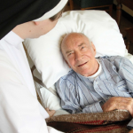Dominican nun cares for elderly patient