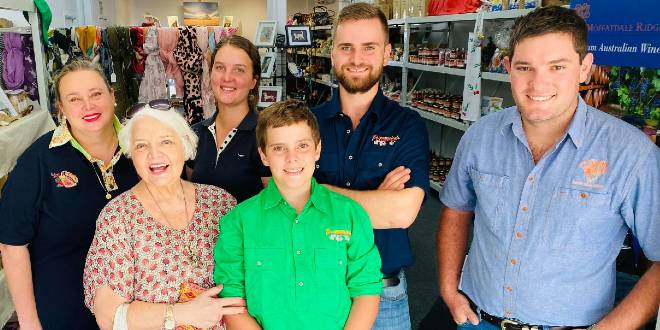 Volunteers and customers at the Buy from the Bush Queensland pop up store in Brisbane