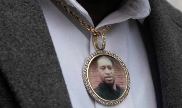 An image of George Floyd hangs from a necklace worn by a family member after a prayer session in Minneapolis. Photo: CNS