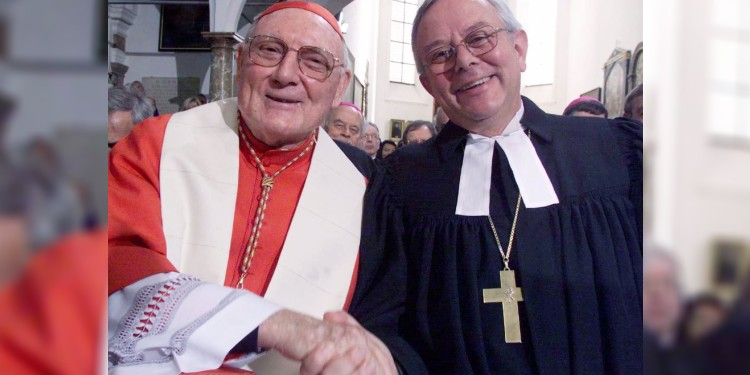 "Cardinal Cassidy with German Lutheran Bishop Christian Krause at the signing of ""The Joint Declaration on the Doctrine of Justification'' in Augsburg, in 1999. Cardinal Cassidy, representing the Vatican, and Bishop Krause, president of the Lutheran World Federation, signed the document marking the resolution of a doctrinal dispute that sparked the Reformation. Photo: CNS"