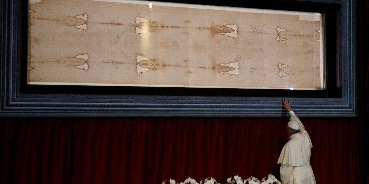 Burial cloths: Pope Francis touches the case holding the Shroud of Turin after praying before the cloth in 2015 at the Cathedral of St. John the Baptist in Turin, Italy.