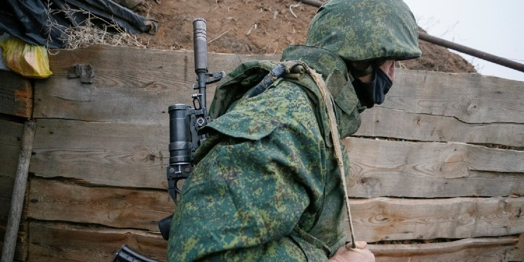 Rebellion: A militant of the separatist Donetsk People's Republic is seen at frontline positions located on the troops contact line with Ukrainian forces near the Ukrainian village of Leninsko on December 18, 2020.