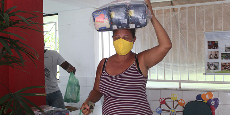 A woman in need receives food aid from AVSI in Boa Vista, Brazil.