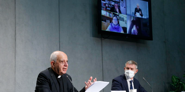 New rite: Archbishop Rino Fisichella, president of the Pontifical Council for Promoting New Evangelization, and Matteo Bruni, director of the Holy See Press Office, participate in a news conference for the release of Pope Francis' document,
