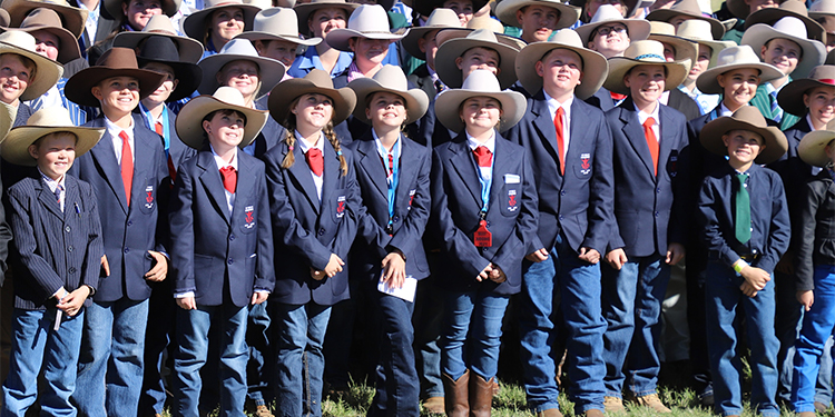 Picking a winner: Members of the St Paul's Catholic Primary School Cattle Judging Team (in navy blazers and red ties) front over 220 contestants in the Beef Australia 2021 Junior Judging Competition for the official event photo. Beef Australia was the first event the team had competed in.