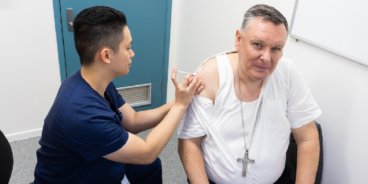 Helping out: Bishop Tim Harris receives his COVID-19 vaccination.