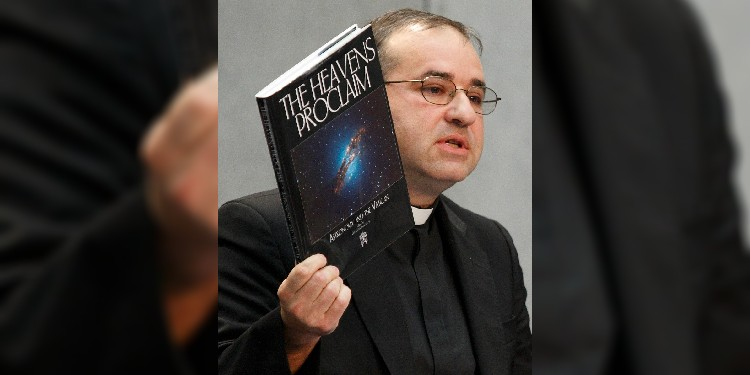Curiosity: Jesuit Father José Funes, then-director of the Vatican Observatory, holds up The Heavens Proclaim book during a news conference at the Vatican.