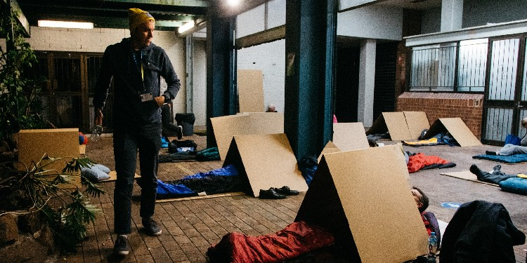 Sleeping rough: Participants prepare to sleep out in the cold outside the St Vincent de Paul Society Queensland's South Brisbane Men's Hostel.