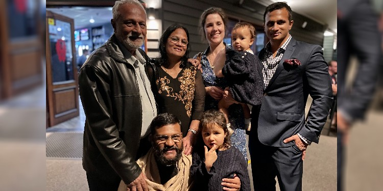 Loving support: Fr Ashwin Acharya with his family.