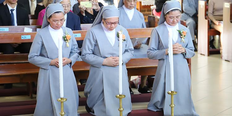 Profession: The three sisters pray together at their perpetual profession.