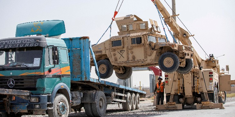 Withdrawal: US Army soldiers and contractors load a military vechicle for transport as U.S. forces prepare for withdrawal, in Kandahar, Afghanistan.