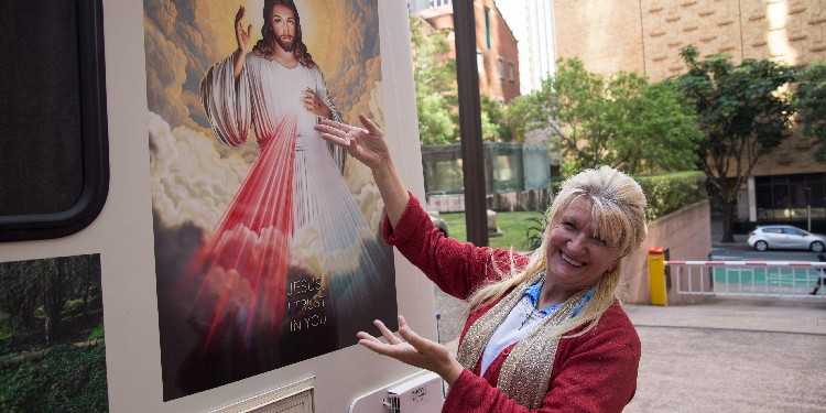Holy trip: Ms Jaskola shows the Divine Mercy image on the side of her campervan.